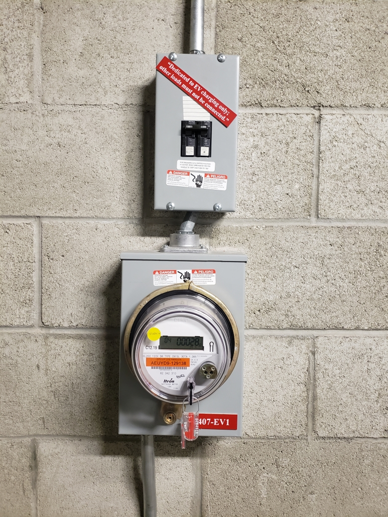 This is a picture of an installation where the power is being read from or utility meter with a 50 amp disconnect for Tesla charging station.