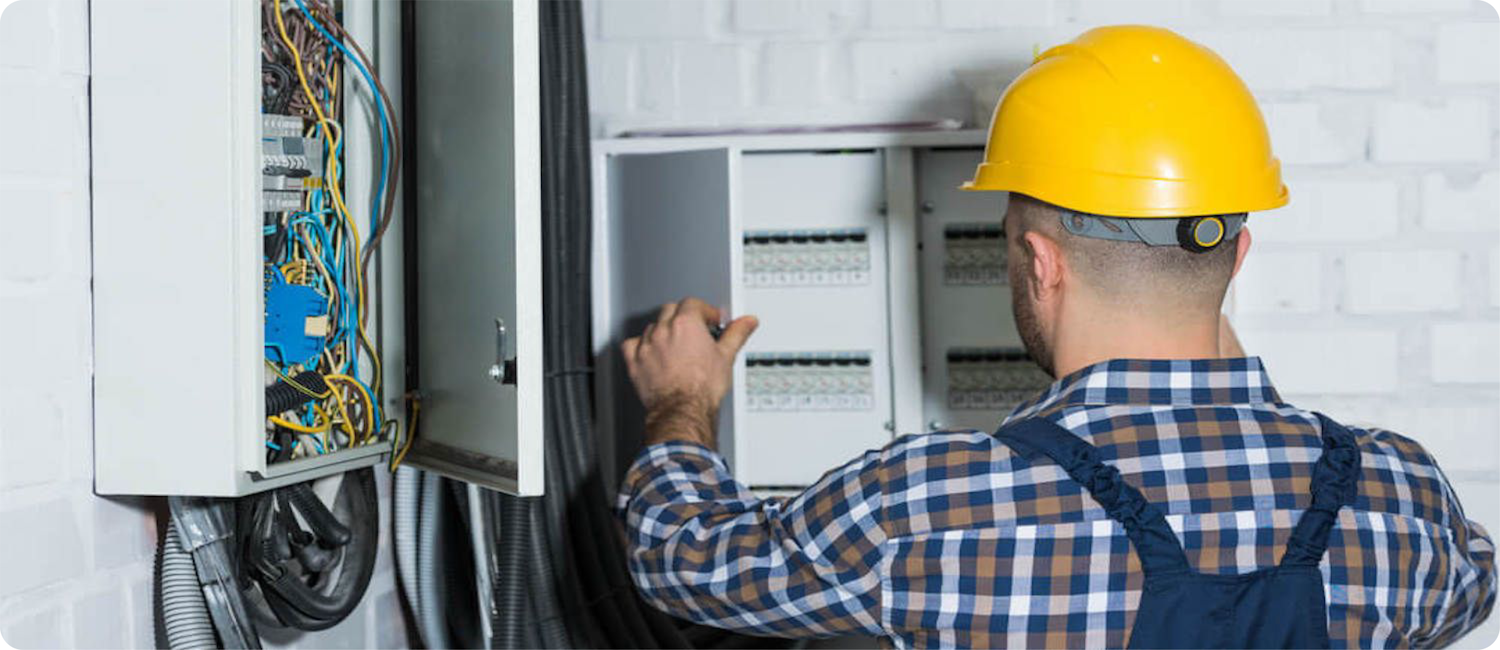 commercial electrician working on panel