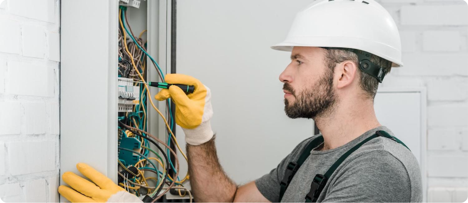 commercial electrician working on a sub panel